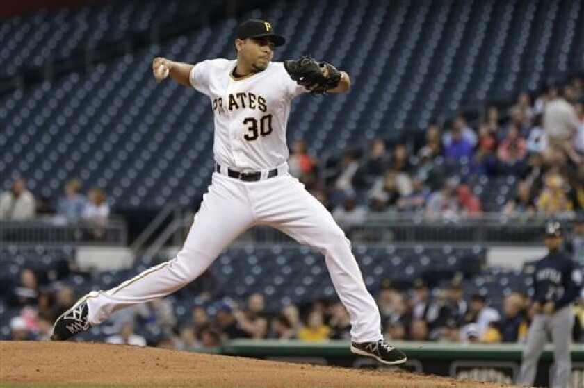 Pittsburgh Pirates starting pitcher Jeanmar Gomez (30) delivers during the third inning of an interleague baseball game against the Seattle Mariners in Pittsburgh, Tuesday, May 7, 2013. (AP Photo/Gene J. Puskar)