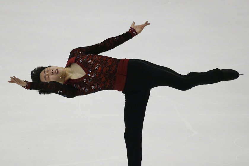 Jin Boyang of China performs during the Mens Short program of the Taiwan ISU Four Continents Figure Skating Championships in Taipei, Taiwan, Friday, Feb. 19, 2016. Jin finished in first place. AP Photo/Wally Santana)