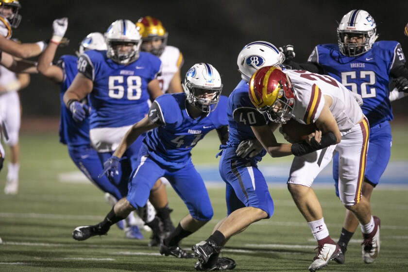 Torrey Pines running back Cael Helfrich gained 147 yards on 27 carries and scored two TDs.