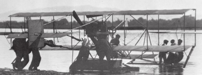 The Curtiss hydroaeroplane is guided into San Diego Bay on Jan. 26, 1911.