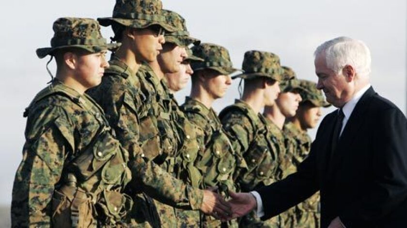 Defense Secretary Robert M. Gates greets Marine recruits at Camp Pendleton in Oceanside on Monday. In his first official visit to Southern California, he emphasized the sacrifices made by families of sailors and Marines.