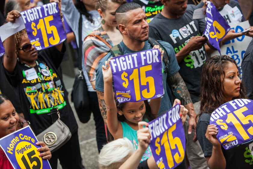 Labor groups rally for an increase in the minimum wage in L.A. County to $15 by 2020 outside the county hall of administration in downtown Los Angeles on July 21.