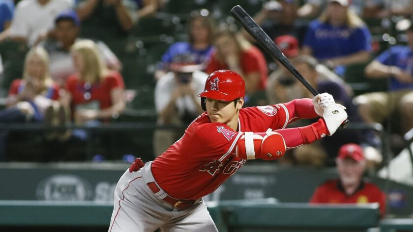 Los Angeles Angels' Shohei Ohtani gets out of the away of an inside pitch by Texas Rangers relief pi