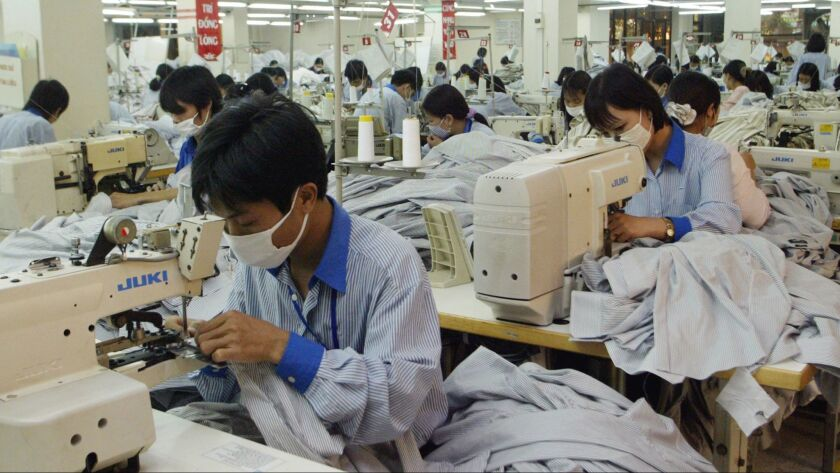 Vietnamese workers in 2007 sew shirts to be exported to the United States.