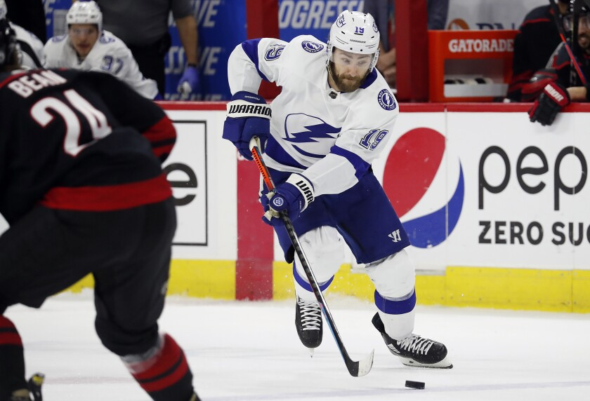 Tampa Bay Lightning's Barclay Goodrow (19) brings the puck up the ice against the Carolina Hurricanes during the first period in Game 2 of an NHL hockey Stanley Cup second-round playoff series in Raleigh, N.C., Tuesday, June 1, 2021. (AP Photo/Karl B DeBlaker)