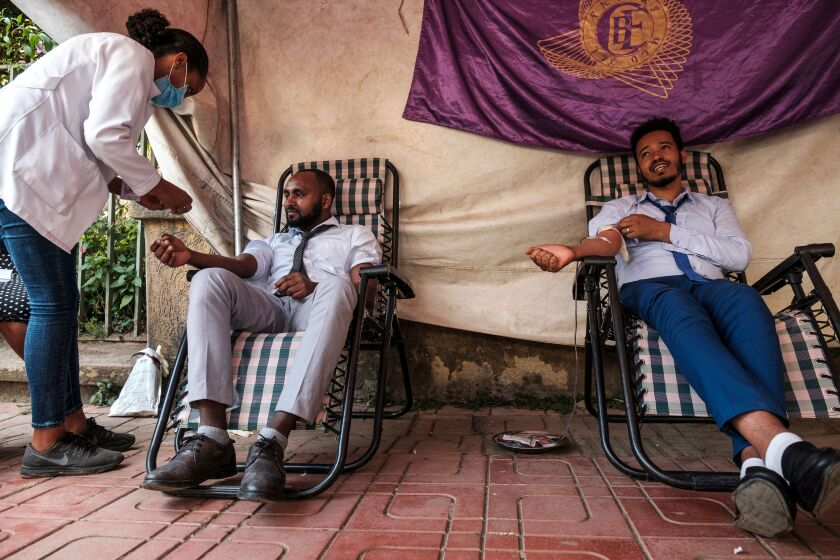 A nurse assists people while they donate blood in the city of Gondar, Ethiopia, Friday.