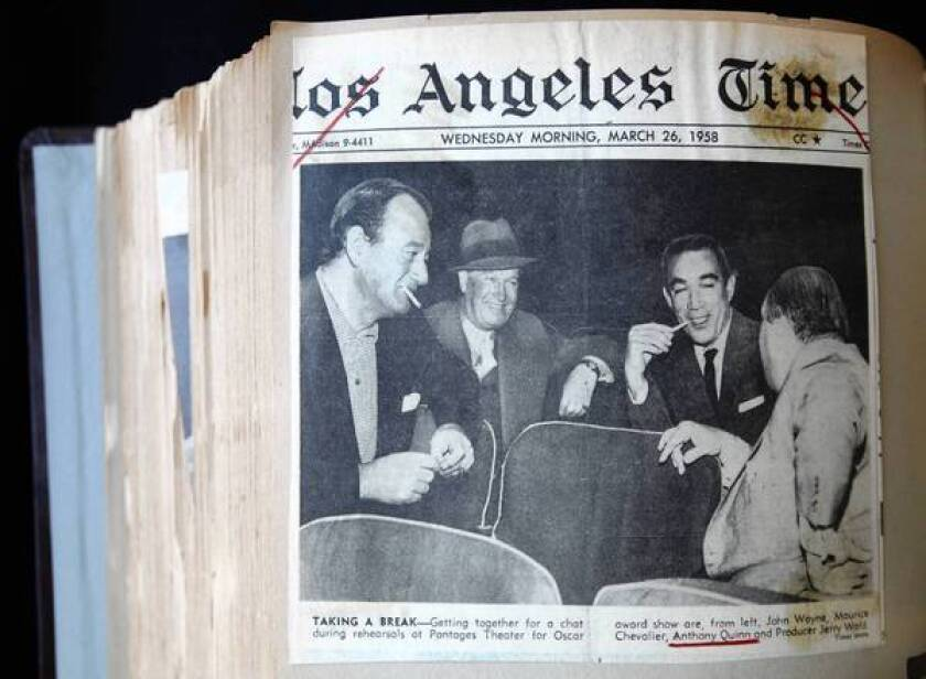 The front page of the Los Angeles Times from March 26, 1958, has a photo of John Wayne and Anthony Quinn; it is part of Quinn's personal archives at the Anthony Quinn Public Library in East Los Angeles.