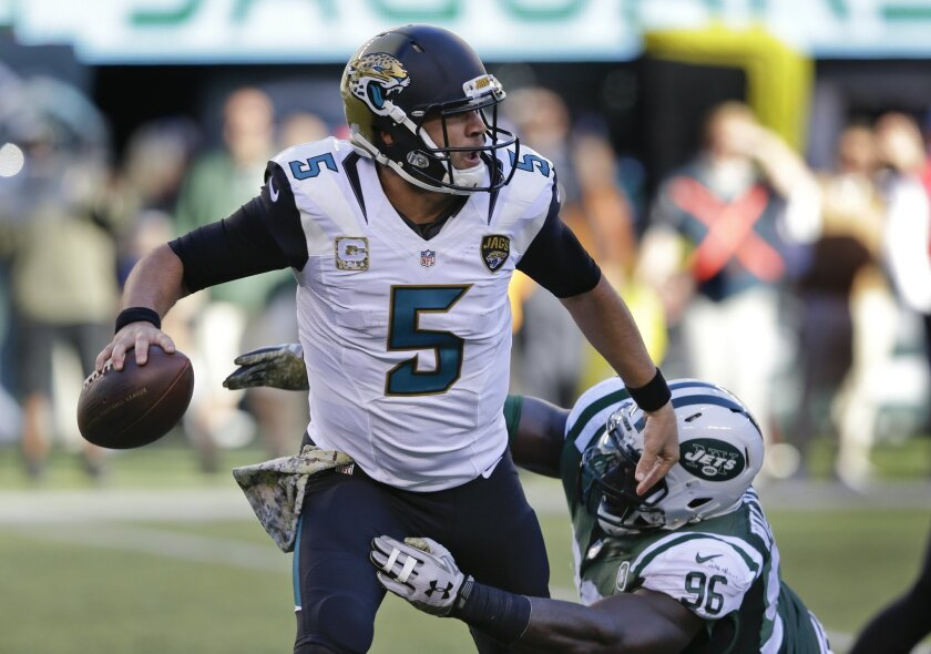 Jacksonville Jaguars quarterback Blake Bortles (5) is pressured by New York Jets defensive end Muhammad Wilkerson (96) during the third quarter of an NFL football game, Sunday, Nov. 8, 2015, in East Rutherford, N.J. (AP Photo/Seth Wenig)