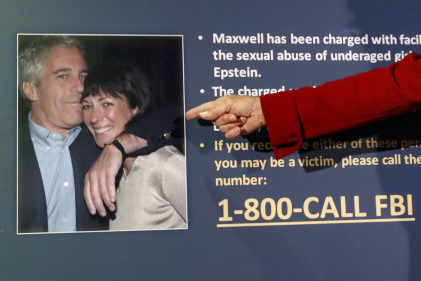 Acting U.S. Atty. Audrey Strauss points to a photo of Jeffrey Epstein and Ghislaine Maxwell at a news conference on July 2.