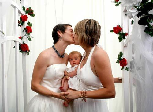 Tori and Kate Kuykendall, who have been together five years, inaugurate their new marriage with a kiss. With them at the ceremony in a park in West Hollywood is their 5-month-old daughter, Zadie. More coverage • With gay marriage now legal in California, it's the start of a couples' crush • Opponents of gay marriage stay mostly quiet -- for now