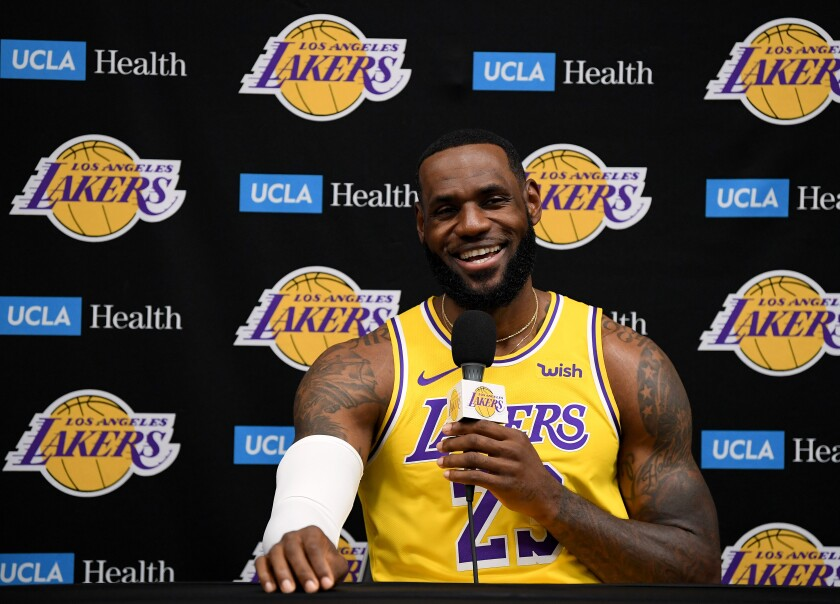 LeBron James smiles while speaking to reporters during Lakers media day in El Segundo on Friday.