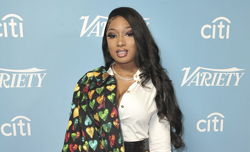 Rapper Megan Thee Stallion, shown from the waist up at a Variety magazine event, with a slight smile