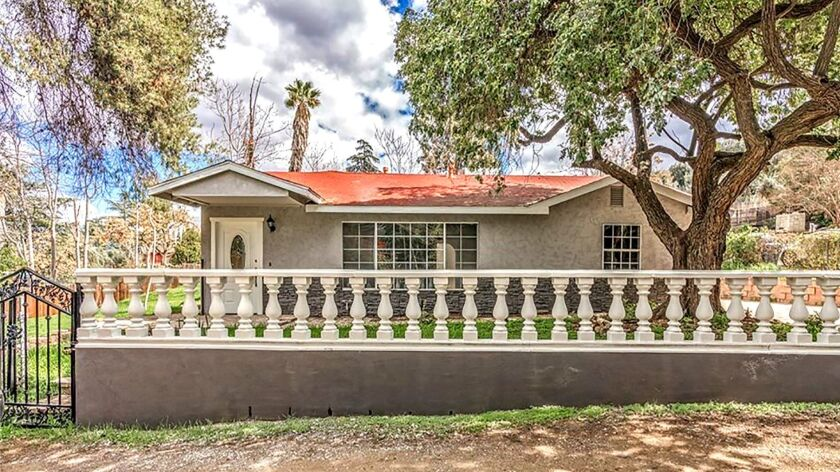 REDLANDS: A down-to-the-studs remodel has left this single-story house sporting new paint, floors, c
