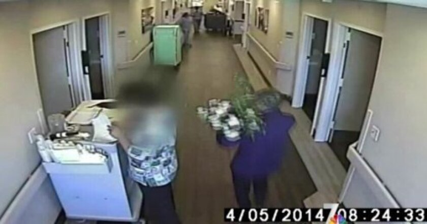 Screen shot of robert Stella's alleged abuser sneaking into the care facility where he is recovering.