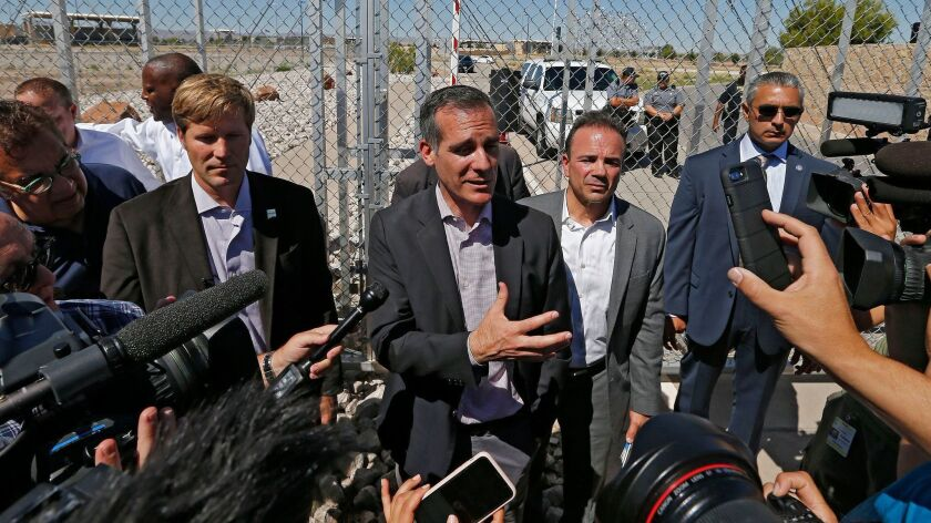 Los Angeles Mayor Eric Garcetti, center, in Tornillo, Texas, last month. The Times has gone to court in an attempt to obtain records related to Garcetti's security costs when he travels out of state.