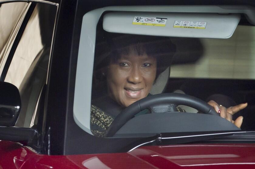 Former South African President Nelson Mandela's daughter Makaziwe leaves a Pretoria hospital after visiting her father.