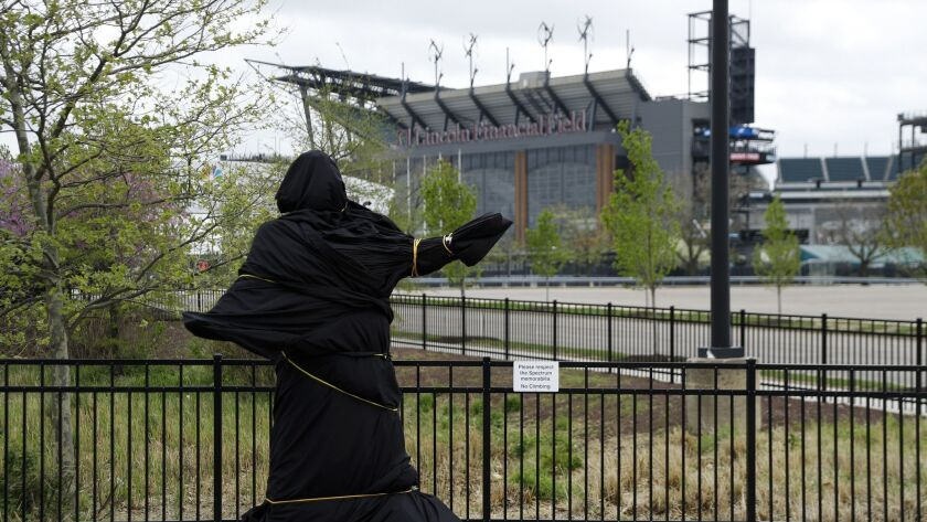 A covered statue of singer Kate Smith is seen near the Wells Fargo Center, Friday, April 19, 2019, i