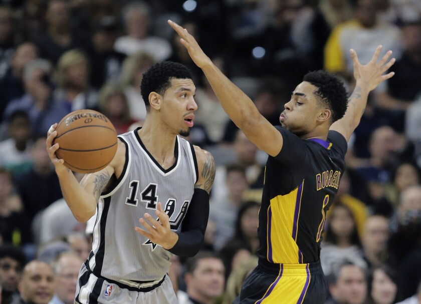 San Antonio Spurs guard Danny Green (14) is defended by Los Angeles Lakers guard D'Angelo Russell (1) during the first half on Friday.