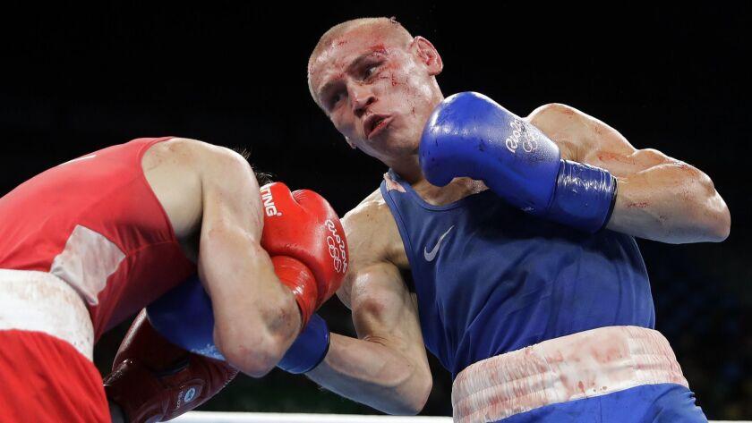 Russia's Vladimir Nikitin, right, fights Ireland's Michael John Conlan during a men's bantamweight 5