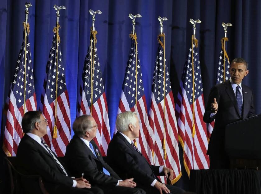 President Obama speaks at an arms control symposium at the National War College in Washington as Secretary of Defense Leon E. Panetta, left, former Sen. Sam Nunn (D-Ga.) and Sen. Richard G. Lugar (R-Ind.) look on.