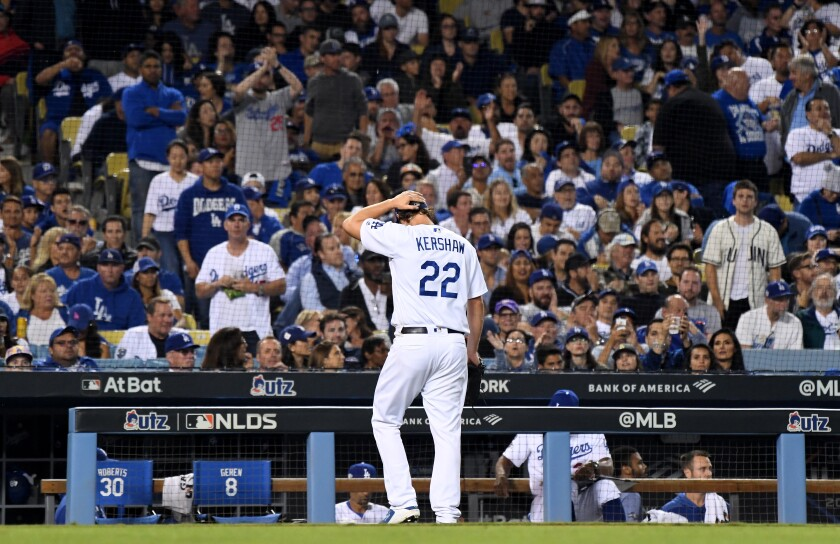 Dodgers pitcher Clayton Kershaw walks back to the dugout after giving up two solo home runs to the Washington Nationals in the eighth inning in Game 5 of the NLDS at Dodger Stadium on Wednesday.