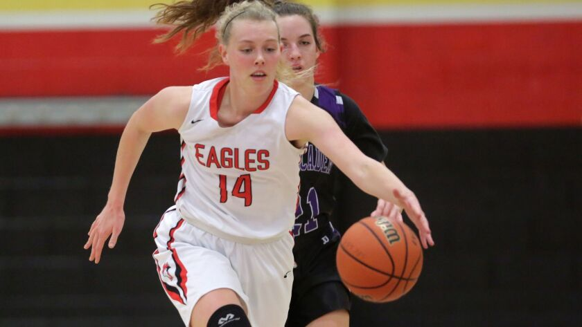 Santa Fe Christian's Emma Dudley — a 6-foot-1 junior — is averaging 17.9 points and 9.8 rebounds a game this season for the Eagles.
