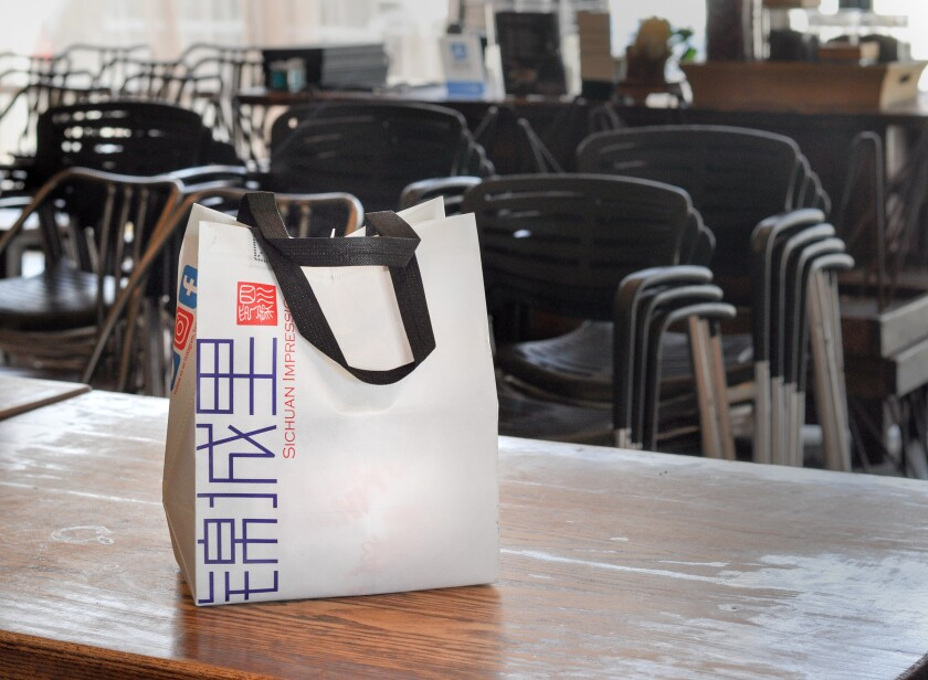 A takeout bag at Alhambra's Sichuan Impression is sealed and reusable by customers.