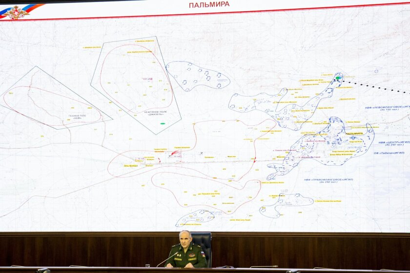 Lt.-Gen. Sergei Rudskoi of the Russian Military General Staff, speaks to the media, with a map of the area around Palmyra seen in the background in Moscow, Russia, Friday, March 18, 2016. Russia's Defense Ministry says its warplanes in Syria are supporting the Syrian army's offensive on Palmyra. (AP Photo/Alexander Zemlianichenko)