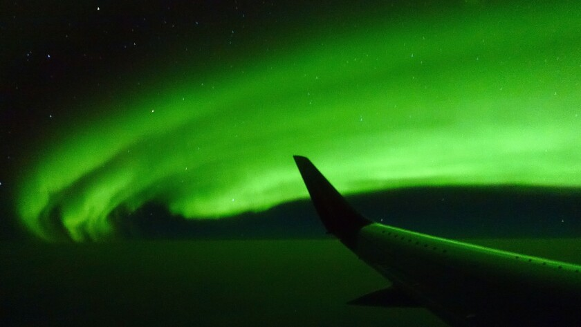 Northern Lights aboard a chartered 737