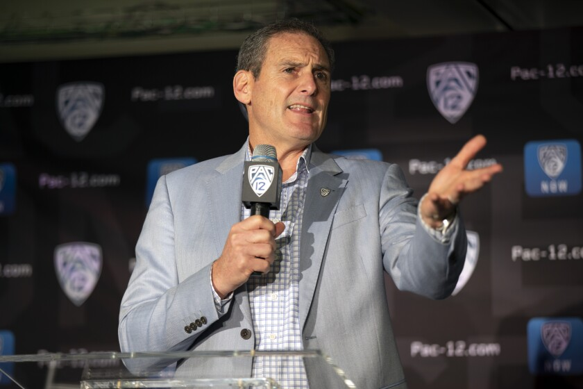 Commissioner Larry Scott speaks during the 2019 Pac-12 NCAA college basketball media day in San Francisco.