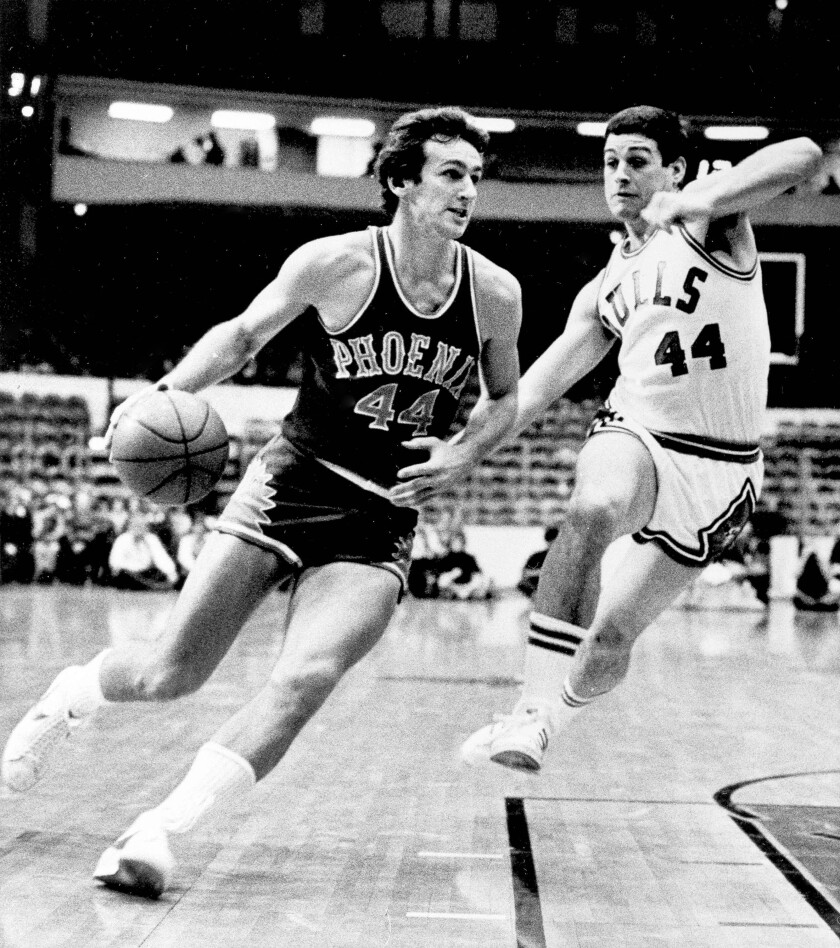 Phoenix Suns guard Paul Westphal, left, drives to the basket ahead of Chicago Bulls guard Tom Kropp during the 1976 season.