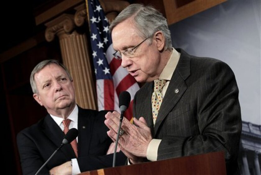 Insisting there is too much to do for lawmakers to spend a week away from the Capitol, Senate Majority Leader Harry Reid of Nev., right, accompanied by Senate Majority Whip Richard Durbin of Ill., speaks to reporters on Capitol Hill in Washington, Thursday, June 30, 2011, after announcing on the fl
