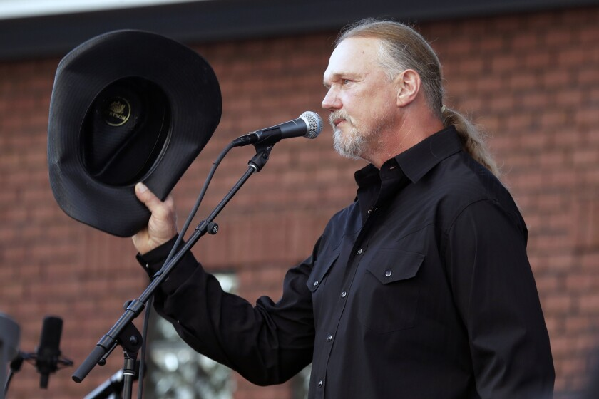 Trace Adkins tips his hat after performing during a memorial service for country music star Charlie Daniels Wednesday, July 8, 2020, in Mount Juliet, Tenn. Daniels died Monday, July 6. (AP Photo/Mark Humphrey)