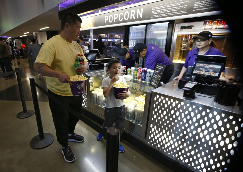 In this photo taken Wednesday, March 11, 2020, fans leave a concession stand at the Golden 1 Center before the Sacramento Kings were scheduled to play the New Orleans Pelicans in an NBA basketball game in Sacramento, Calif. The January jobs report shows the California economy added 21,400 new jobs with the biggest gains in the education, health services and leisure and hospitality services. But with the outbreak of the coronavirus, those numbers could take a drastic downward change with Gov. Gavin Newsom's executive order closing schools, conferences, Disneyland and the NBA's suspension of its season. (AP Photo/Rich Pedroncelli)