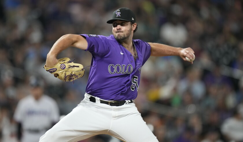 Colorado Rockies relief pitcher Ben Bowden works against the Miami Marlins in the seventh inning of a baseball game Friday, Aug. 6, 2021, in Denver. (AP Photo/David Zalubowski)