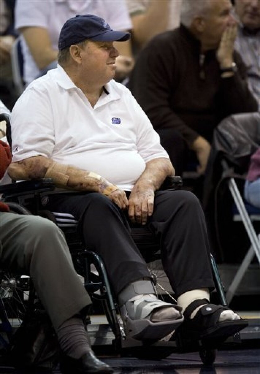In this Dec. 3, 2008, file photo, Utah Jazz owner Larry Miller watches the Miami Heat play his team during an NBA basketball game in Salt Lake City. Miller's legs were amputated 6 inches below the knee on Friday, Jan. 23, 2009. Miller died Friday, Feb. 20, 2009, at home from complications due to Type 2 diabetes. He was 64. (AP Photo/Douglas C. Pizac, File)