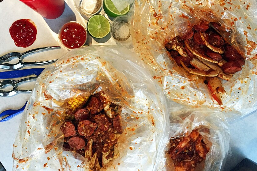 Bags of crab, shrimp and sausage at Boiling Crab in Alhambra.