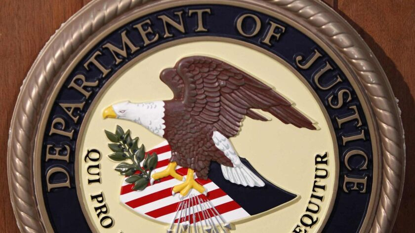 The Department of Justice logo REUTERS/Carlo Allegri (UNITED STATES - Tags: SCIENCE TECHNOLOGY BUSINESS TELECOMS CRIME LAW POLITICS)
