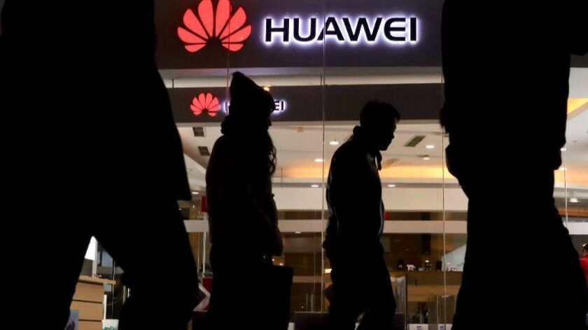 A Huawei retail shop in Beijing. The arrest of the company's chief executive officer, Meng Wanzhou, has put the spotlight on a tech giant that is little known in the United States.