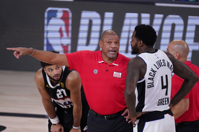 Doc Rivers talks to Clippers forward JaMychal Green during a playoff game against the Nuggets on Sept. 13, 2020.