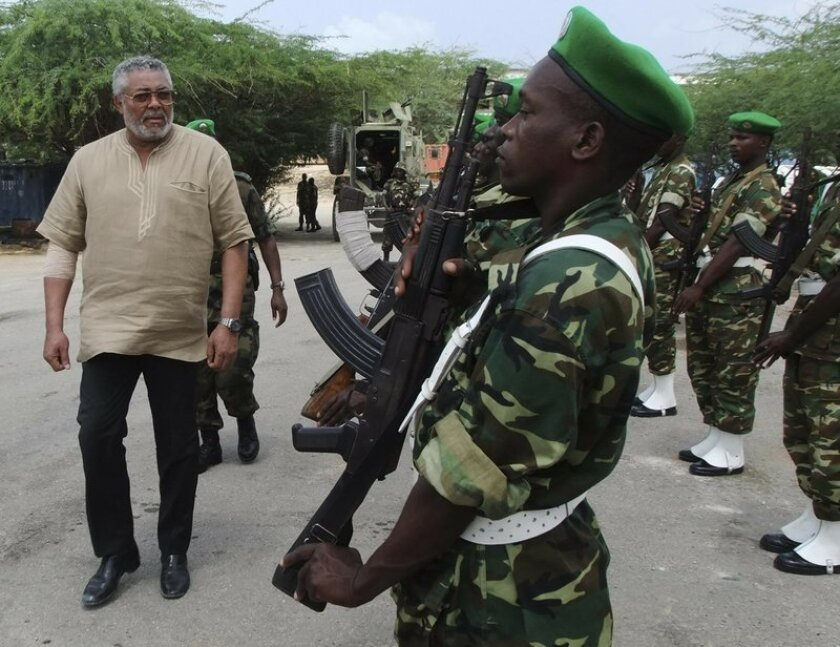 Jerry Rawlings inspects troops in 2011.
