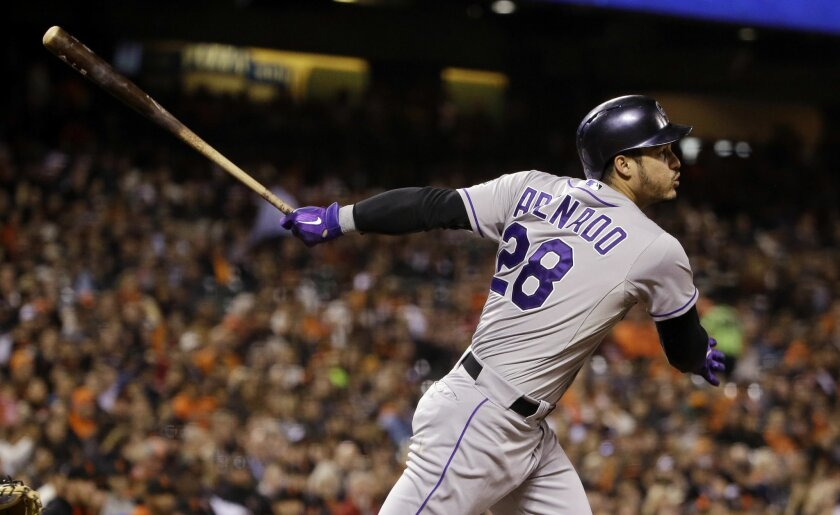 FILE - In this Oct. 2, 2015, file photo, Colorado Rockies' Nolan Arenado drives in two runs with a double against the San Francisco Giants during the third inning of a baseball game, in San Francisco. This is Arenado's team now and the All-Star third baseman is ready to step up to the plate and bec