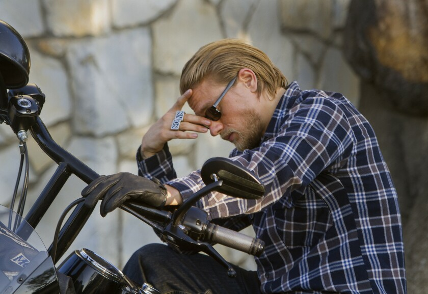 """Charlie Hunnam of """"Sons of Anarchy"""" sits on his motorcycle between takes while on location in North Hollywood."""