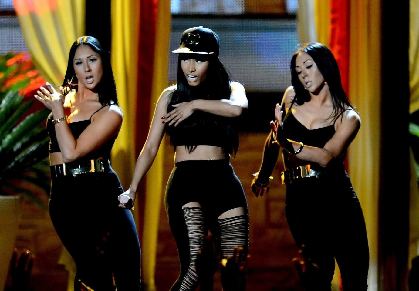 Nicki Minaj, center, performs onstage during the 2013 Billboard Music Awards.