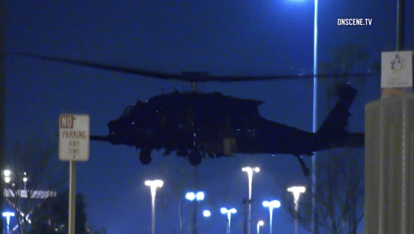 Army invades L A 's space: Black helicopters, loud booms