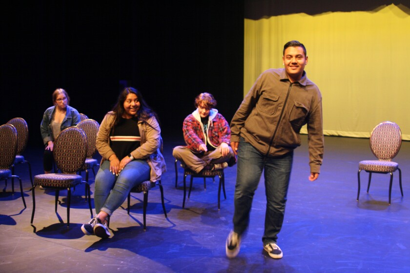 """Oceanside High School drama student Mark Heather shows his """"Magic Foot"""" to fellow spelling bee contestants Sapphire Taylor, Miah Ortiz and Alec Salazar. The Oceanside High School Theatre Department presents """"The 25th Annual Putnam County Spelling Bee"""" on Friday and Saturday."""