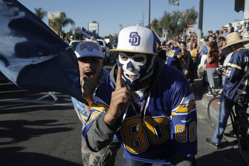 Chargers fans spilled out onto Highland Avenue Sunday afternoon in National City, waving banners, shouting and rocking the cars that made a slow cruise northbound for the one lane not blocked off by police, as they celebrated the Chargers' win over the Cincinnati Bengals.