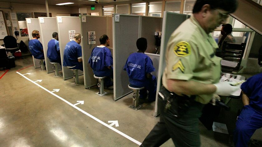 Inmates sitting in the inmate reception center in the Twin Towers jail in 2006. A 28-year-old man was arrested this week on suspicion of attempting to slip into the facility using fake FBI credentials.