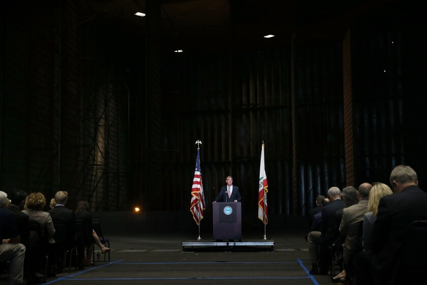 Secretary of Defense Ashton Carter speaks inside of the Unitary Plan Wind Tunnel, the world's largest, at the NASA Ames Research Center in Mountain View, Calif., on Friday.