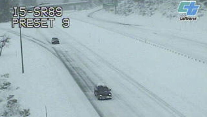 This image from a Caltrans traffic camera shows snow on the Interstate 5 and Highway 89 junction nea